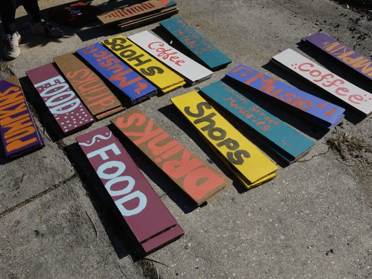 LEE CELANO/THE ADVERTISER Signs pointing to amenities are ready to be hung during Better Block McKinley, which was held last month. Signs pointing to amenities are ready to be hung during Better Block McKinley, a one-day transformation of McKinley Street into a two-way pedestrian friendly street in Freetown Oct. 22, 2016, in Lafayette.