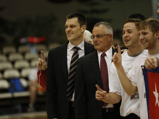 FILE -- Coach Greg Tonagel celebrates an Indiana Wesleyan