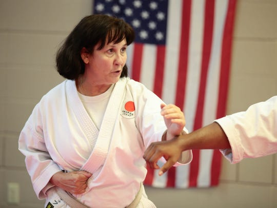 Stroke survivor Rose Shuff leads a karate class at
