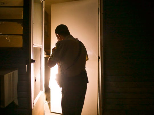 Lafayette Parish Sheriff's Sgt. Clay Carter searches an abandoned apartment for signs of entry and drug activity late Friday, February 17, 2017.