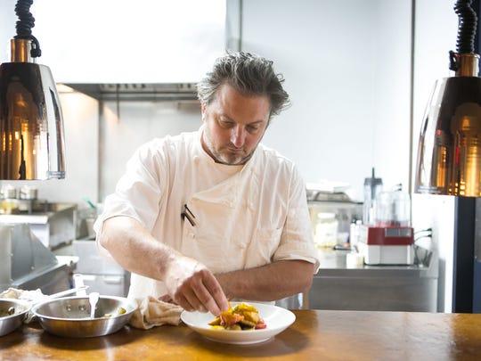 Bryan Sikora prepares a lobster stuffed zucchini blossoms