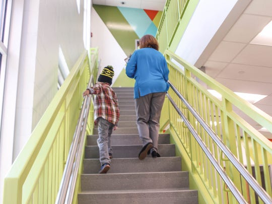 """Walter """"SuperBubz"""" Herbert completes multiple grades of school in one day at Fairfield Central Elementary school on Thursday, Sept. 7, 2017. Walter walks from grade to grade with Principle Karrie Gallo."""