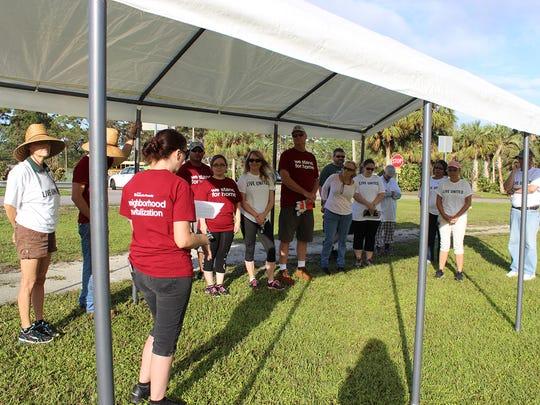 Habitat staff and volunteers at Gifford Youth Achievement Center garden.