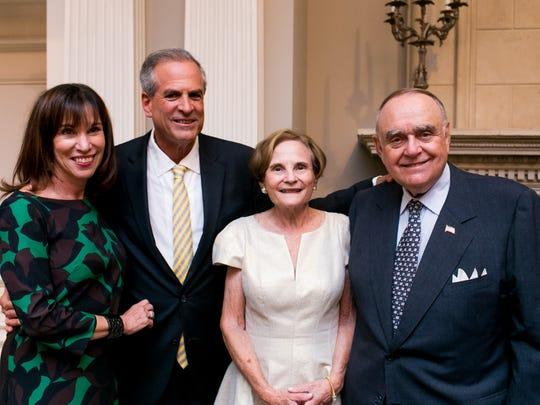 With financier Leon Cooperman (far right) of Short
