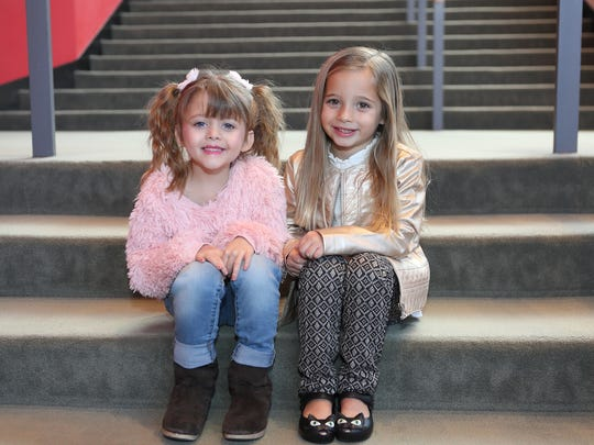Eliana Mann (right) and Isabelle Lee Busch pose for a photo at the Des Moines Civic Center. Mann and Busch will appear as Lulu in the Broadway musical 'Waitress,' running at the Civic Center Dec. 5-10, 2017.