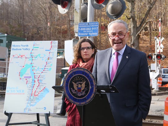 Nancy Montgomery, wife of Jim Lovell of Cold Spring, who died in the 2013 Spuyten Duyvil train derailment, stands with Sen. Chuck Schumer at the Brewster Train Station. Nov. 20, 2017.