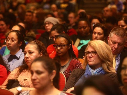 Jen Lopez, center, a student at Albert Leonard Middle School in New Rochelle, was among hundreds of residents at a public meeting at the high school in January to discuss a spate of violence that has taken place in the high school community.
