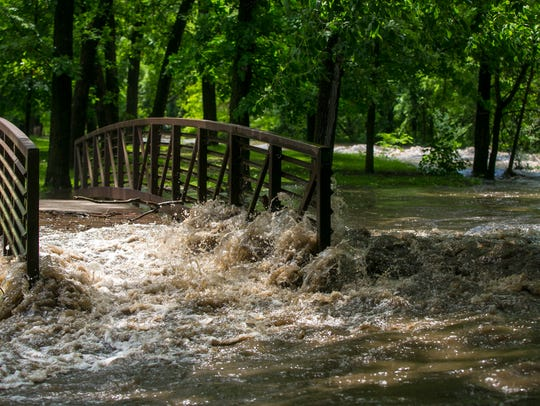 Water from Willow Creek overtakes the footbridge in