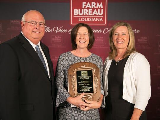 Paula Guildry, center, earned the top teacher in the classroom award.