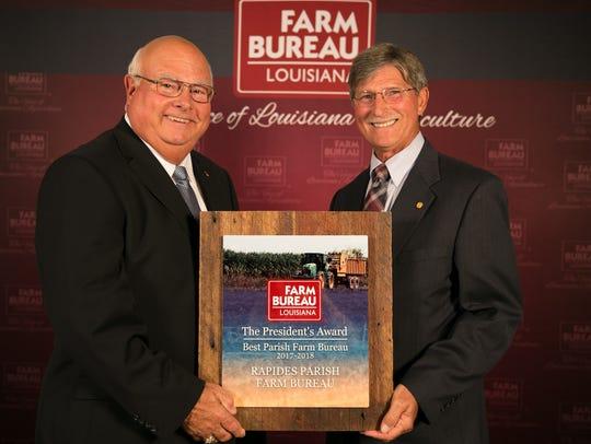 Louisiana Farm Bureau President Ronnie Anderson presents