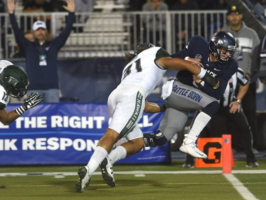 Nevada's Ty Gangi rushes for a touchdown in a game against Hawaii at Mackay Stadium.