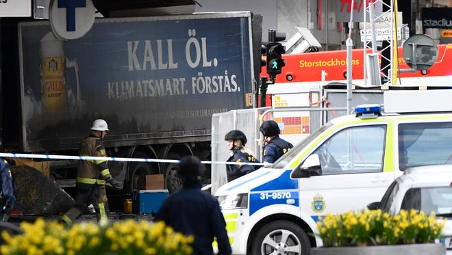 Police cordon off a truck which crashed into the Ahlens department store in central Stockholm on Friday.