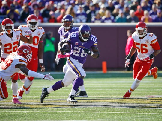 Minnesota Vikings running back Adrian Peterson (28) runs with the ball during the second half of an NFL football game against the Kansas City Chiefs, Sunday, Oct. 18, 2015, in Minneapolis. (AP Photo/Ann Heisenfelt)