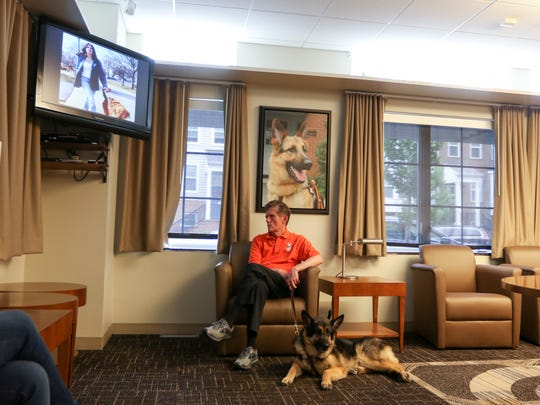 Jim Kutsch sits while people watch a short video about the The Seeing Eye, a guide dog school during the  Walking Tour in Morristown on June 23, 2018.
