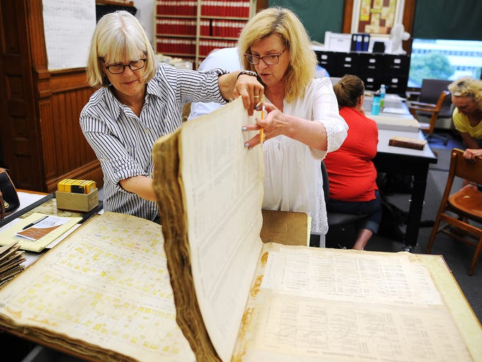 Deb Weber, left, and Sarah Stowers, an All Saints Neighborhood homeowner, page through a Sioux Falls Sanborn Map Company map book during a Home History Research event, where homeowners can research historic facts about their home, on Saturday, July 26, 2014, at the Old Courthouse Museum in downtown Sioux Falls, S.D.