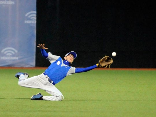 Alec Pinkerton dives to catch a fly ball April 14 during Southeastern's game against Huntington at VA Memorial Stadium.