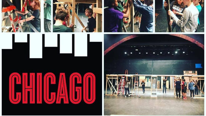 The Wauwatosa West Trojan Players Tech Crew of students create the stage for the production of Chicago.