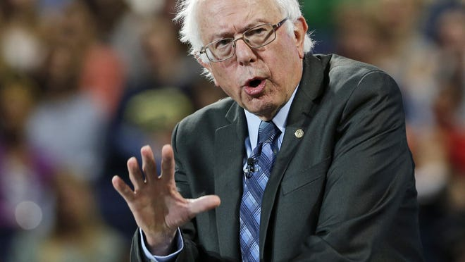 Democratic presidential candidate Sen. Bernie Sanders, I-Vt., gestures during a speech Monday at Liberty University in Lynchburg, Virginia.
