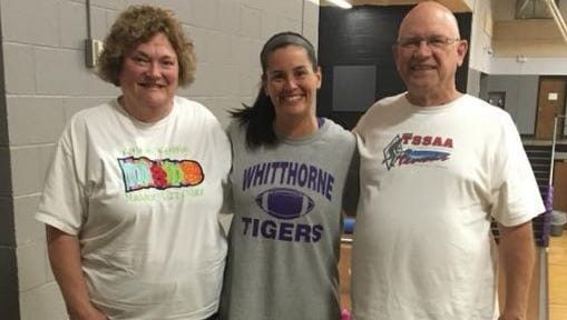 The recently hired Dickson County High School girls basketball coach Erin Webb, a former player at DCHS, with her Lady Cougar coach Eve Hamilton. Pictured, right, is Eve's husband, Henry.