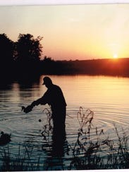A hunter is getting ready for a duck hunt.