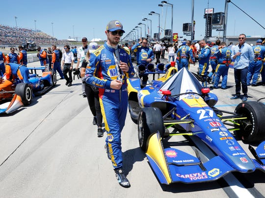 Alexander Rossi walks to his car before an IndyCar