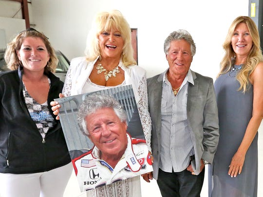 Debra Crosby (left) and Nancy George (far right) join Linda Vaughn and Mario Andretti for some snap shots during the 500 Prelude party.