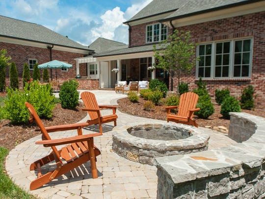Comfortable chairs are arranged around the fire pit
