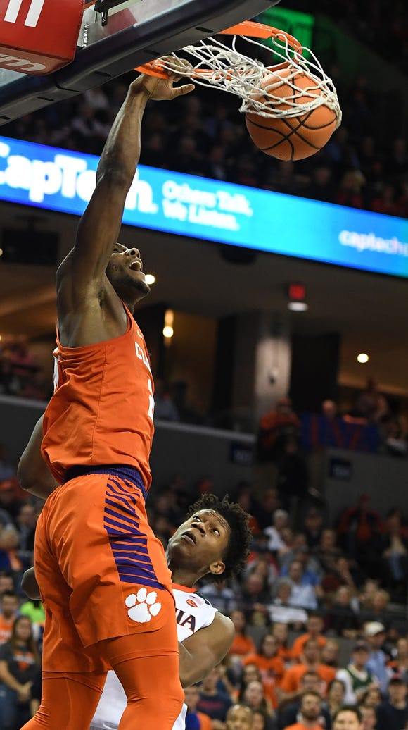 Clemson forward Aamir Simms (25) dunks against Virginia