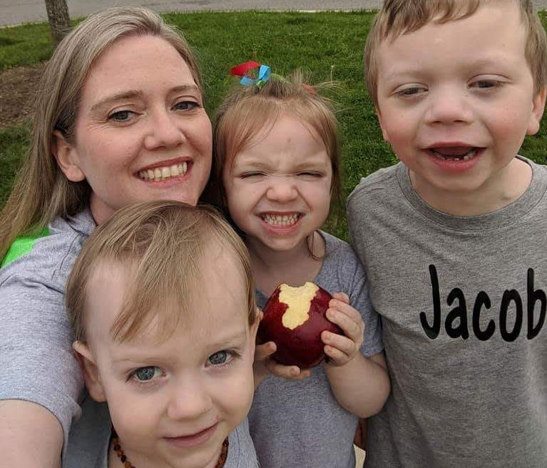 A photo posted to her Facebook page features Julie Edwards with her children Paxton, Brinley and Jacob.