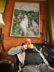 Jeff McDonald, of Wausau, enjoys his coffee Friday afternoon at Allister Deacon's Coffee House in downtown Wausau.