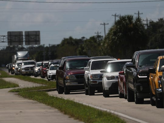 Motorists wait in line to get gas at Love's on Bayshore