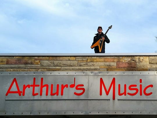 Bonamassa recreates the 1959 photograph of Kenny Si with the 1958 Flying V on the roof of Arthur's Music Store.