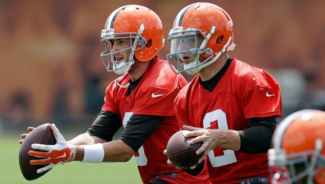 Browns quarterbacks Brian Hoyer, left, and Johnny Manziel are expected to battle for the starting job through preseason.