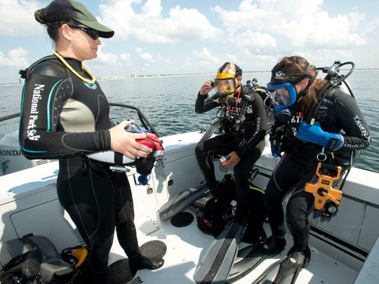 From left, Jessica Keller, National Park Service submerged resources diver, assists fellow divers Kara Fox and Jessica Glickman for their dive off Perdido Key in 2014.
