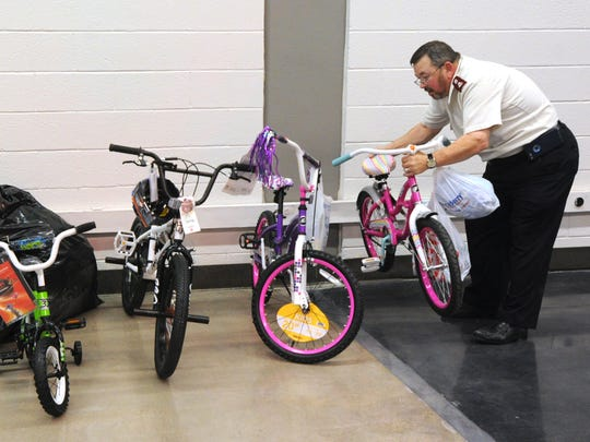 Salvation Army Major Russ Keeney brings out bikes at the Toys for Tots Thursday, Dec. 15, 2016.