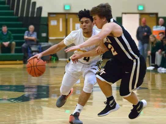 Pennfield's Deveaire Todd (4) drives the basket midway