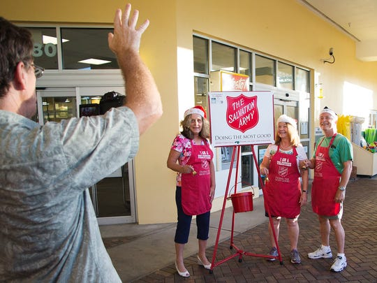 Bill Rogers, left, records Dianne Ducharme, center, Kris Volpone and her husband Sam Volpone, for a Salvation Army public service announcement (PSA) Saturday at the Publix Supermarket at Summerlin Crossings in south Fort Myers. Kara Jeudy, director of development for the Salvation Army Fort Myers Area Command, hopes the PSA will attract holiday bell ringers. Jeudy estimates more than 275 local bell ringers will be needed for the upcoming holiday season. All money collected in the famous red kettles supports local services provided by the Salvation Army. Homeless assistance, outreach centers, corrections counseling and no cost medical care are among the services. Go to salvationarmyleecounty.org for volunteer information.