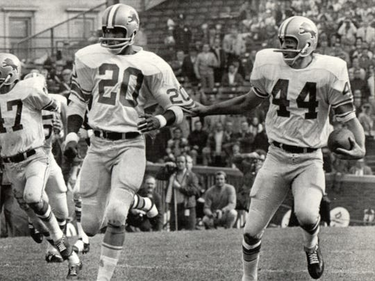 After intercepting a pass against the Chicago Bears in the 2nd quarter, Detroit Lions cornerback Dick LeBeau (44) tugs on the sleeve of teammate Lem Barney (20) to indicate the desired path for his 26-yard runback. The Lions won 16-10 on Oct. 25, 1970.