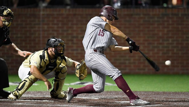 Mississippi St. center fielder Jake Mangum (15) hits a two-run double in the second inning at the NCAA Super Regional Saturday, June 9, 2018, at Hawkins Field in Nashville, Tenn.