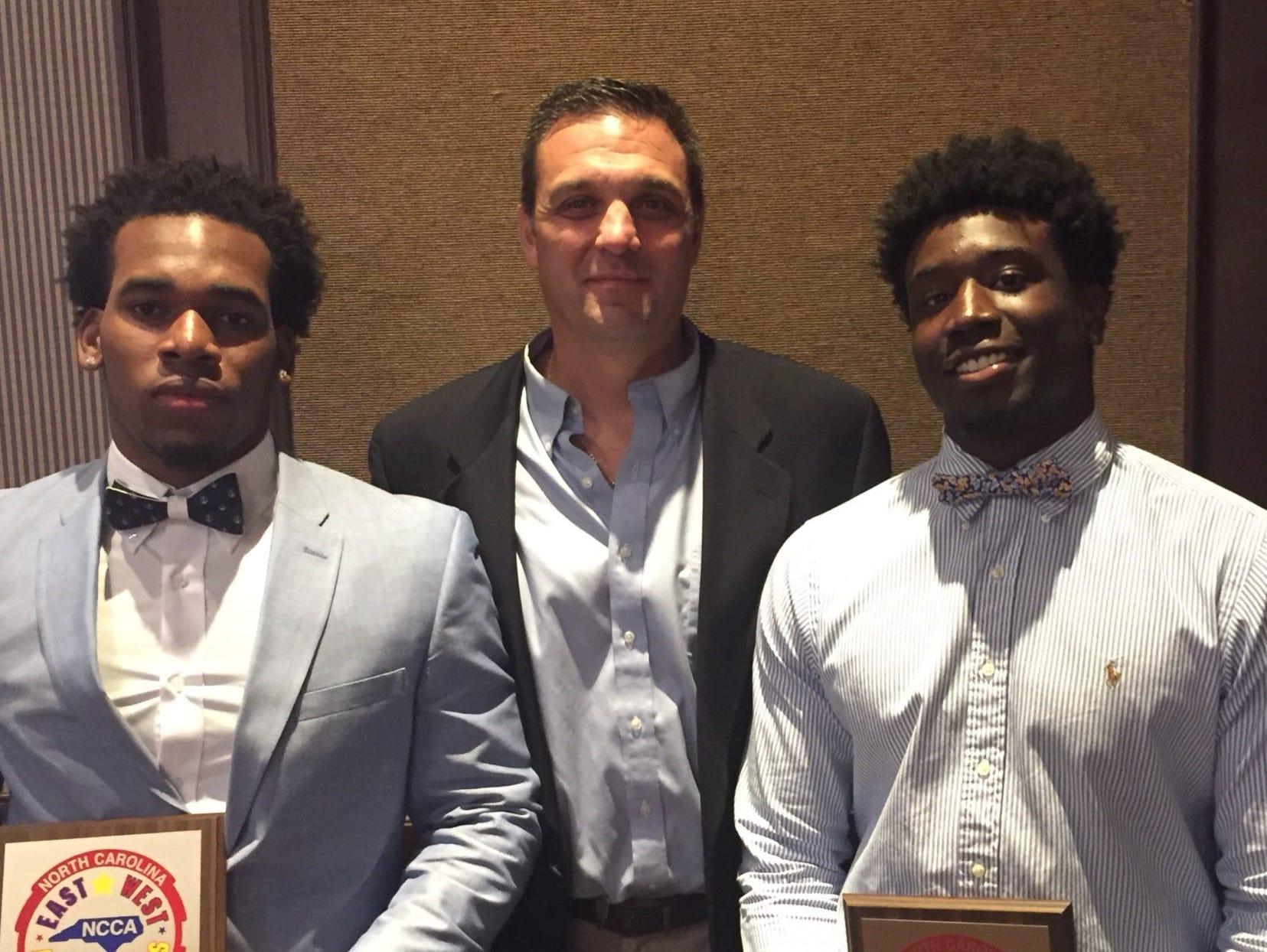 Reynolds football coach Shane Laws with Aundreas Hill and Najae Buchanan.