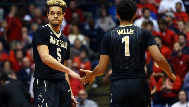 Vanderbilt guard Matthew Fisher-Davis (5) reacts to guard Payton Willis (1) making a basket to against Dayton on Dec. 21, 2016.