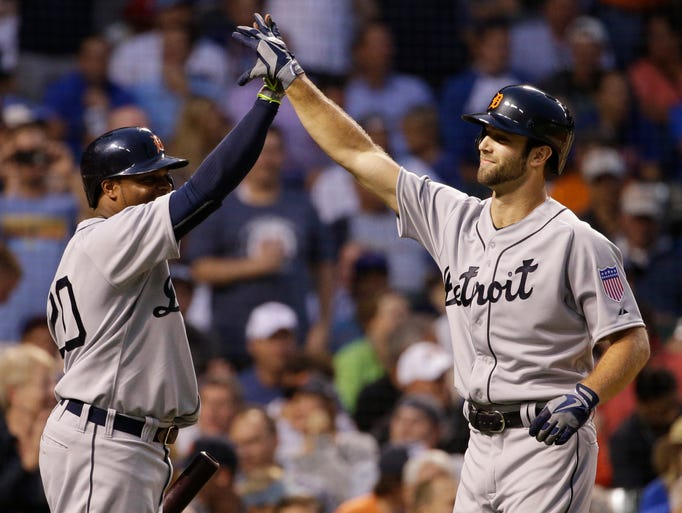 Detroit Tigers' Daniel Norris, right, celebrates with