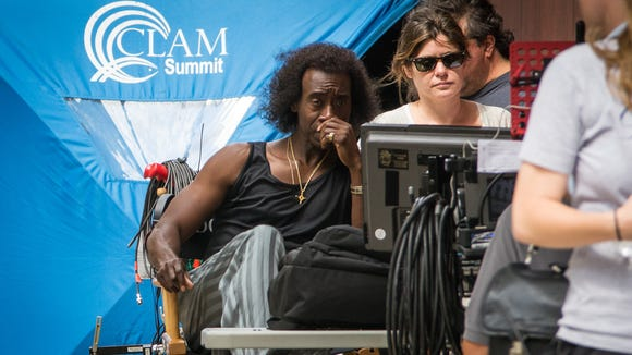 """Actor-director Don Cheadle, dress as Miles Davis, and producer Pamela Hirsch, watch a """"Miles Ahead"""" scene Monday."""