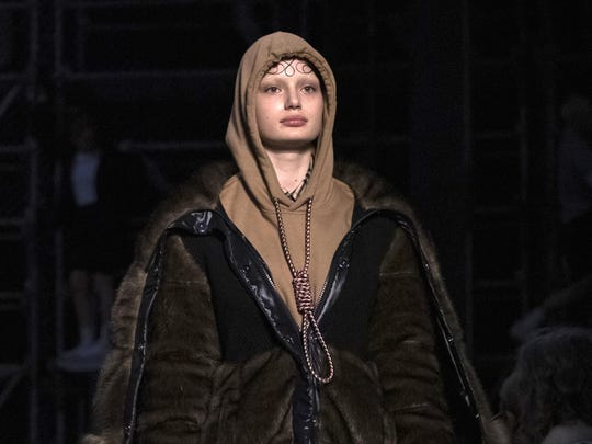This Feb. 17, 2019, photo shows a model wearing a creation by Burberry at the Autumn/Winter 2019 fashion week runway show in London. The chief executive and chief creative officer of luxury powerhouse Burberry have apologized for putting a hoodie with strings tied in the shape of a noose on their London Fashion Week runway.