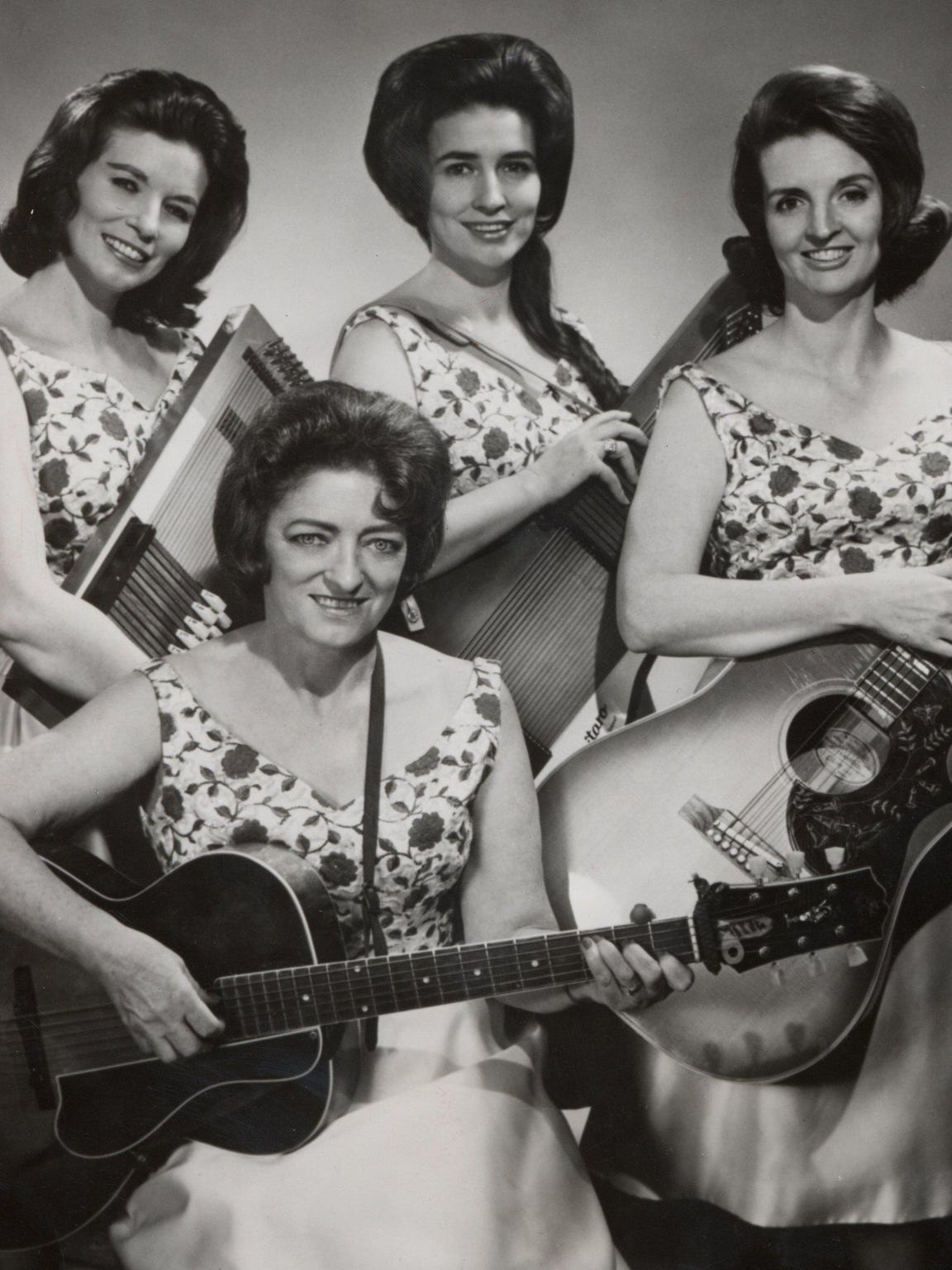 The repertoire of the Carter Family —  Maybelle Carter, seated, and daughters June, Anita and Helen — is heavily laced with gospel music.