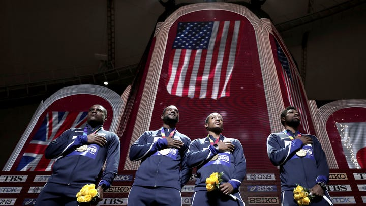 Gold medalists from left, Christian Coleman, Justin Gatlin, Michael Rodgers and Noah Lyles of the United States take part in the medal ceremony for the men's 4x100 meter relay at the World Athletics Championships in Doha, Qatar, Sunday, Oct. 6, 2019. (AP Photo/Nariman El-Mofty)