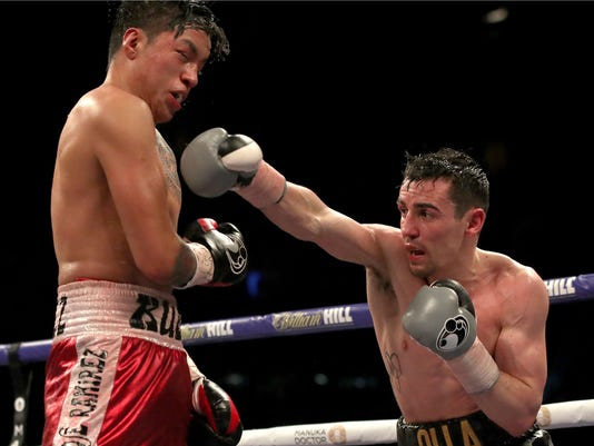 Anthony Crolla, right, in action against Edson Ramirez in their Lightweight contest at the Principality Stadium in Cardiff, Wales, Saturday March 31, 2018.   Carolla went on to win the contest against Ramirez, on the undercard Saturday, ahead of the main event unification title fight between heavyweight contenders Anthony Joshua or Joseph Parker.  (Nick Potts/PA via AP)