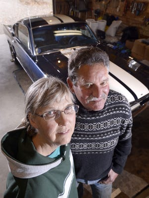 """Dave and Kaye Persell show their 1965 Ford Mustang Fastback, originally owned by rocker Bob Seger, at home in their garage. The car will be featured on an episode of """"Americarna"""" set to air on the Velocity network Tuesday."""