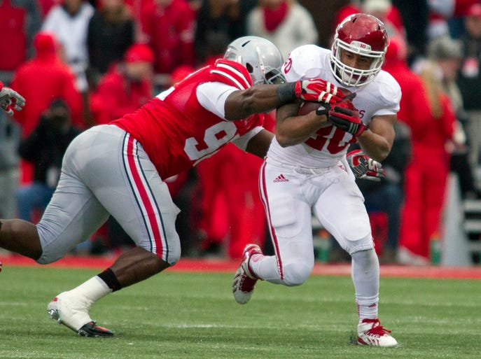 Indiana Hoosiers running back D'Angelo Roberts (20) runs the ball in the first quarter and is tackled by Ohio State Buckeyes defensive lineman Adolphus Washington (92) at Ohio Stadium. Mandatory Credit: Trevor Ruszkowksi-USA TODAY Sports