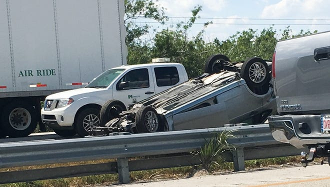 Car flipped just south of Eau Gallie Boulevard exit on Interstate 95.
